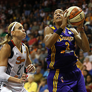Candace Parker, (right), Los Angeles Sparks, drives past Katie Douglas, Connecticut Sun, during the Connecticut Sun Vs Los Angeles Sparks WNBA regular season game at Mohegan Sun Arena, Uncasville, Connecticut, USA. 3rd July 2014. Photo Tim Clayton