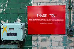 © Licensed to London News Pictures. 01/12/2013. London, UK. Image date: 28 August 2012. A 'thank you' sign inside the inside the Wapping Project restaurant (formerly the Wapping Hydraulic Power Station) stating that the venue has been created without lottery funds or public revenue. The Wapping Project restaurant and art space will close at the end of 2013. Photo credit : Vickie Flores/LNP