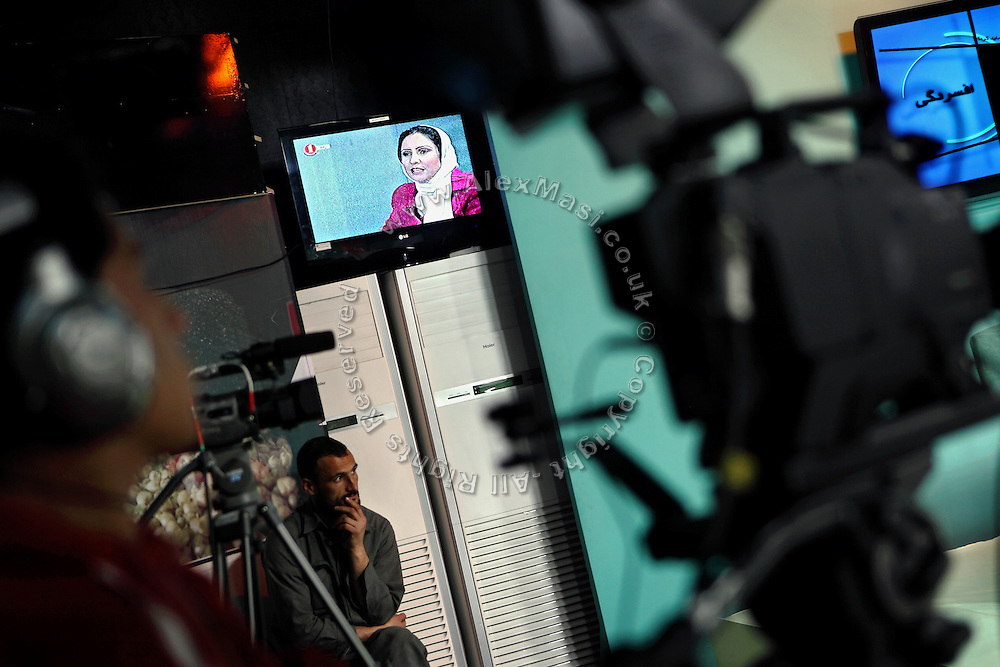 Azita Arif Nazimi, 25, (centre) is presenting 'Family Live Show', a television program broadcasted live by Channel 1, an Afghan national television, in Kabul, Afghanistan.