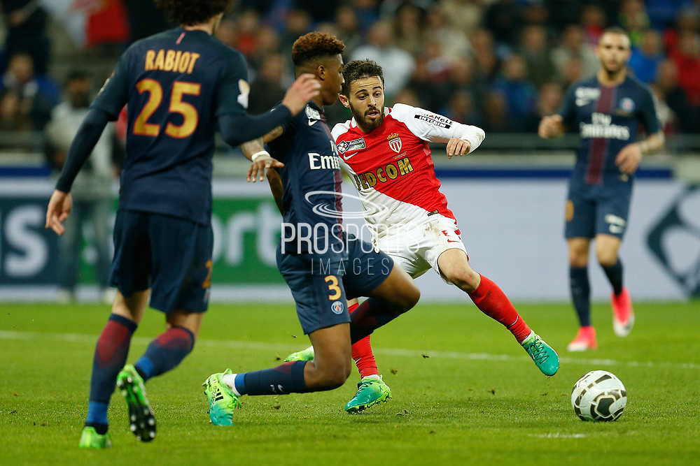 Monaco's Portuguese midfielder Bernardo Silva vies with Paris Saint-Germain's French defender Presnel Kimpembe during the French League Cup, Final football match between AS Monaco and Paris Saint-Germain FC on April 1, 2017 at the Parc Olympique Lyonnais stadium in Decines-Charpieu near Lyon, France - Photo Benjamin Cremel / ProSportsImages / DPPI