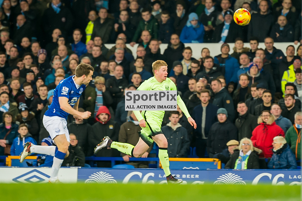 Manchester City midfielder Kevin De Bruyne and Everton defender Seamus Coleman chase a loose ball in the Football League cup semi-final first leg at Goodison Park, Liverpool