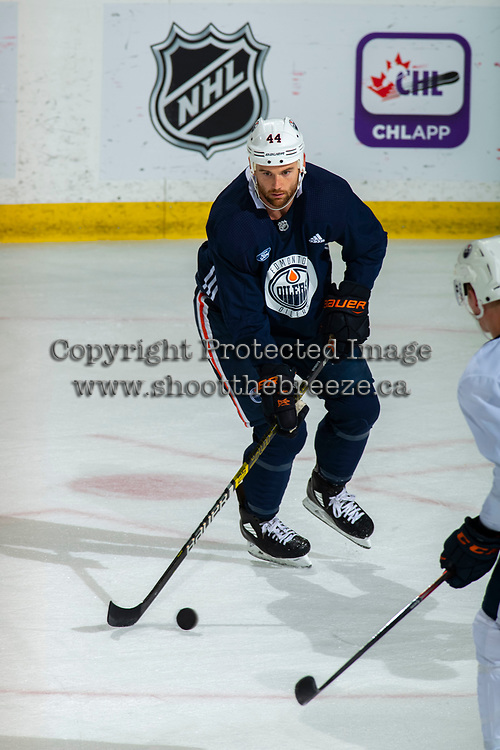 KELOWNA, BC - SEPTEMBER 22:  Zack Kassian #44 of the Edmonton Oilers skates with the puck during practice at Prospera Place on September 22, 2019 in Kelowna, Canada. (Photo by Marissa Baecker/Shoot the Breeze)