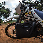 Data clerk Oscar Kai will head to an outreach clinic on a motorcycle, with his laptop and shoulder carried cooler of vaccines. After a bumpy 20 minute ride on dirt roads, a distance that would take a mother carrying her baby on foot, more than two hours, Mr. Kai sets up his laptop on a desk in a rural classroom where children will receive vaccinations, and their health records will be captured digitally.<br /> <br /> &quot;Because the database is digitized, it means its far easier to keep our records fresh, even if children move and access health services in different locations,&quot; says Dr.Benjamin Tsofa, the Kenyan health ministry's chief liaison on the study. <br /> <br /> In January 2011, the Kenyan government with support from the GAVI Alliance, introduced a new vaccine, PCV-10, which targets 10 bacteria than can cause Invasive Pneumococcal Disease.The vaccine's impact is monitored through an electronic database, part of the GAVI funded PCV impact study, which maps the growing coverage of the new vaccine. Already, here in Kilifi, the incidence of the illness in children aged five has gone down by approximately two-thirds.