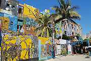HAVANA, CUBA - OCTOBER 22, 2006: Building exterior with the street art paintings in Havana, Cuba. Popular tourist location El Alley Hamel is a solo project of a local artist Salvador Gonzalez.