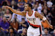 Nov 2, 2016; Phoenix, AZ, USA; Portland Trail Blazers guard Evan Turner (1) points on the court during the first half against the Phoenix Suns at Talking Stick Resort Arena. The Suns defeated the Trail Blazers 118-115 in overtime. Mandatory Credit: Jennifer Stewart-USA TODAY Sports