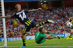 27.08.2013, Emirates Stadion, London, ENG, UEFA CL Qualifikation, FC Arsenal vs Fenerbahce Istanbul, Rueckspiel, im Bild Arsenal's Wojciech Szczesny makes a save from Fernerbache's Raul Meireles during the UEFA Champions League Qualifier second leg match between FC Arsenal and Fenerbahce Istanbul at the Emirates Stadium, United Kingdom on 2013/08/27. EXPA Pictures © 2013, PhotoCredit: EXPA/ Mitchell Gunn<br /> <br /> ***** ATTENTION - OUT OF GBR *****