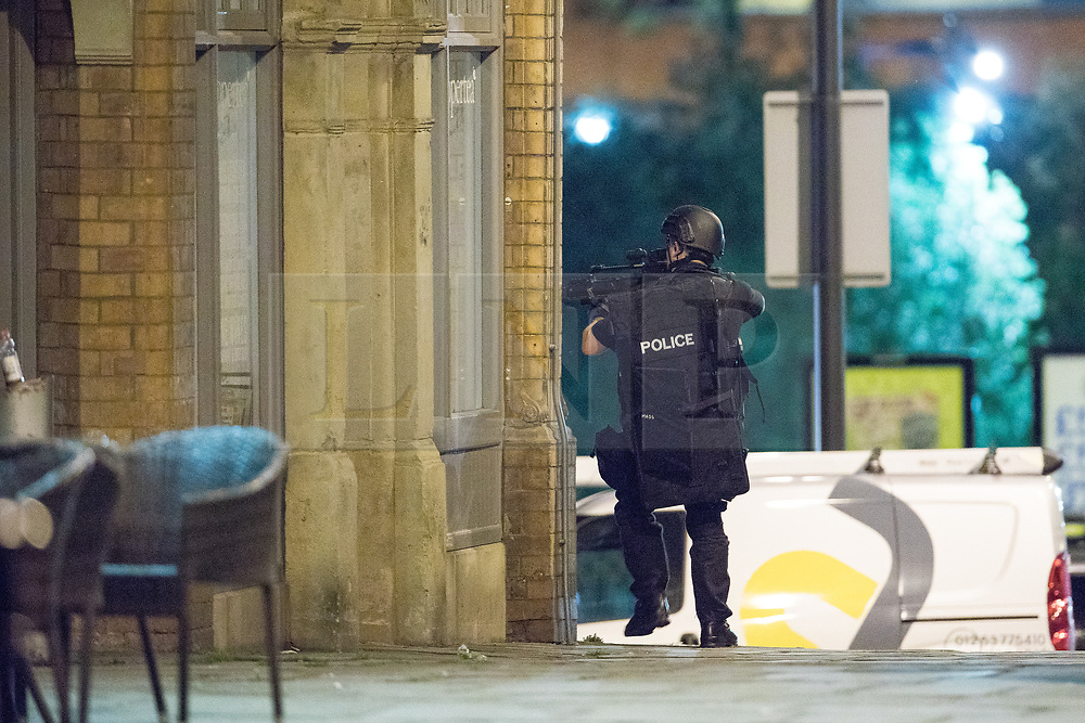 © Licensed to London News Pictures . FILE PICTURE DATED 22/05/2017 as Manchester prepares to mark a year since the Manchester Arena terror attack . Manchester, UK. Armed police search and clear Cathedral Gardens ahead of carrying out a controlled explosion . Police and other emergency services are seen near the Manchester Arena after Salman Abedi murdered 22 and injured dozens more at an Ariana Grande concert at Manchester Arena. Photo credit : Joel Goodman/LNP
