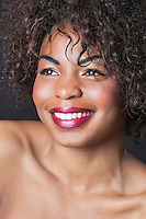 Extreme close-up of smiling young African American woman
