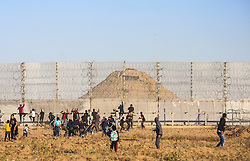 May 3, 2019 - Gaza, Gaza - Palestinian protesters seen on the boarder wall during clashes..At least 50 Palestinians were injured in clashes between demonstrators who joined the weekly anti-Israel protests and Israeli soldiers stationed on the border between eastern Gaza Strip and Israel, medics said. (Credit Image: © Nidal Alwaheidi/SOPA Images via ZUMA Wire)
