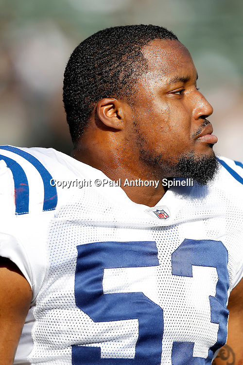 Indianapolis Colts linebacker Kavell Conner (53) looks on during the NFL week 16 football game against the Oakland Raiders on Sunday, December 26, 2010 in Oakland, California. The Colts won the game 31-26. (©Paul Anthony Spinelli)