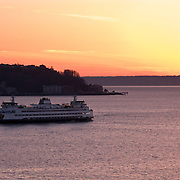 Ferryboat leaving Seattle waterfront, sunset, Elliott Bay, Seattle, Washington