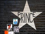 "22 APRIL 2016 - MINNEAPOLIS, MN: Prince's star on the wall of 1st Ave in Minneapolis. Thousands of people came to 1st Ave in Minneapolis Friday to mourn the death of Prince, whose full name is Prince Rogers Nelson. 1st Ave is the nightclub the musical icon made famous in his semi autobiographical movie ""Purple Rain."" Prince, 57 years old, died Thursday, April 21, 2016, at Paisley Park, his home, office and recording complex in Chanhassen, MN.    PHOTO BY JACK KURTZ"
