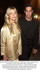 Model MISS JEMMA KIDD and MR NIC LOEB, at a party in London on 3rd February 2001.OLB 109