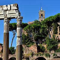 Temple of Venus Genetrix at Forum of Caesar in Rome, Italy<br /> Julius Caesar claimed to be a descendant of Venus, the Roman goddess of love, beauty, sex and victory. After his victory at the Battle of Pharsalus (48 BC), he promised to build a temple in the deity's honor at Forum of Caesar. He portrayed her as Venus Genetrix, meaning the mother of his ancestors. The temple was destroyed and rebuilt in the early 2nd and late 3rd centuries. Only three of the original 16 columns of the temple still stand. In the background is Tabularium. This government structure was constructed in 78 BC to house city records and offices.