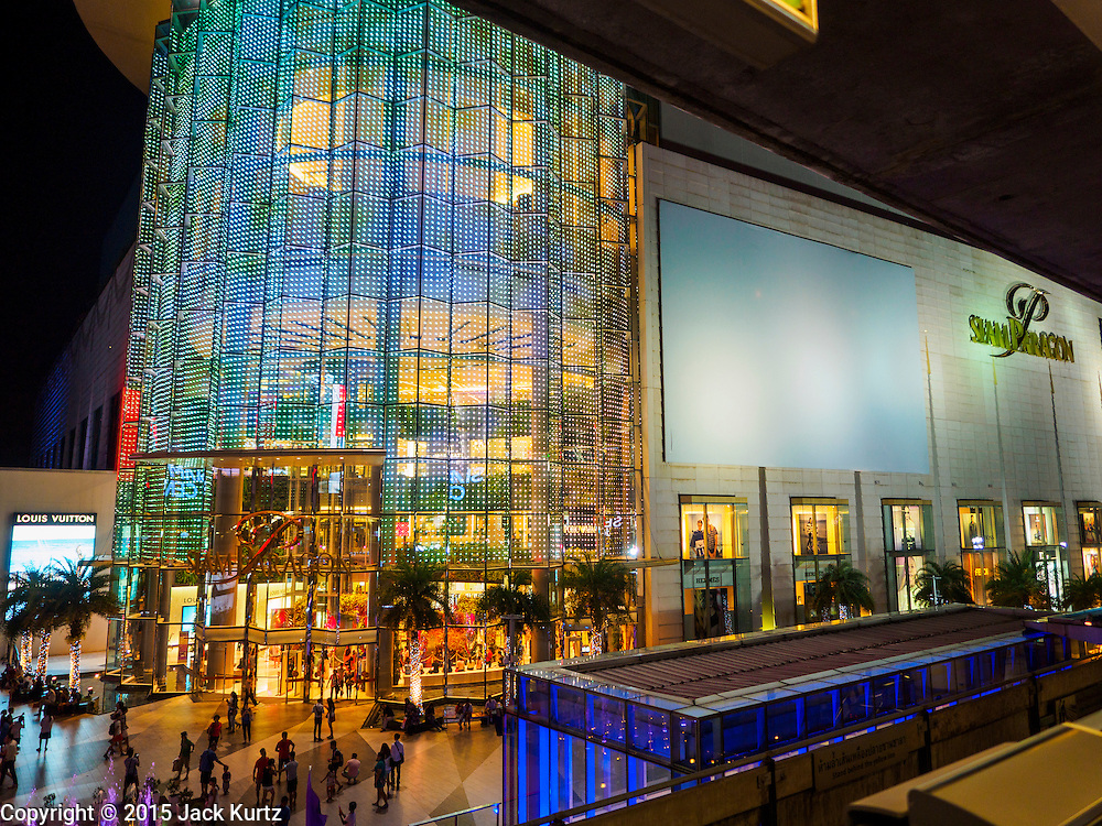 20 MAY 2015 - BANGKOK, THAILAND: Siam Paragon is one of the most popular malls in Bangkok. Bangkok's malls consume more electricity than some provinces. Siam Paragon, a popular high end mall in central Bangkok, consumes nearly twice as much electricity at the northern province of Mae Hong Son. Thais and foreigners alike flock to the malls in Bangkok, which are air conditioned. Most of the electricity consumed in Bangkok is generated in Laos and Myanmar. In 2013, the Bangkok Metropolitan Region consumed about 40 per cent of the Thailand's electricity, even though the BMR is only 1.5 per cent of the country's land area and about 22 per cent of its population.   PHOTO BY JACK KURTZ