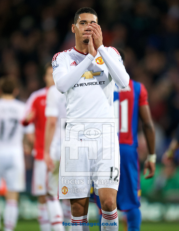 Chris Smalling of Manchester United thanks the fans after their 0-0 draw in the Barclays Premier League match at Selhurst Park, London<br /> Picture by Alan Stanford/Focus Images Ltd +44 7915 056117<br /> 31/10/2015