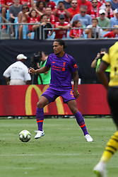 July 22, 2018 - Charlotte, NC, U.S. - CHARLOTTE, NC - JULY 22:  virgil van Dijk (4) of Liverpool looks to pass the ball during the International Champions Cup soccer match between Liverpool FC and Borussia Dortmund in Charlotte, N.C. on July 22, 2018.(Photo by John Byrum/Icon Sportswire) (Credit Image: © John Byrum/Icon SMI via ZUMA Press)