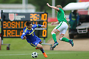Ajdin Hasic of Bosnia and Herzegovina (10) and Luca John Connell of Republic of Ireland (18) tackle each other during the UEFA European Under 17 Championship 2018 match between Bosnia and Republic of Ireland at Stadion Bilino Polje, Zenica, Bosnia and Herzegovina on 11 May 2018. Picture by Mick Haynes.