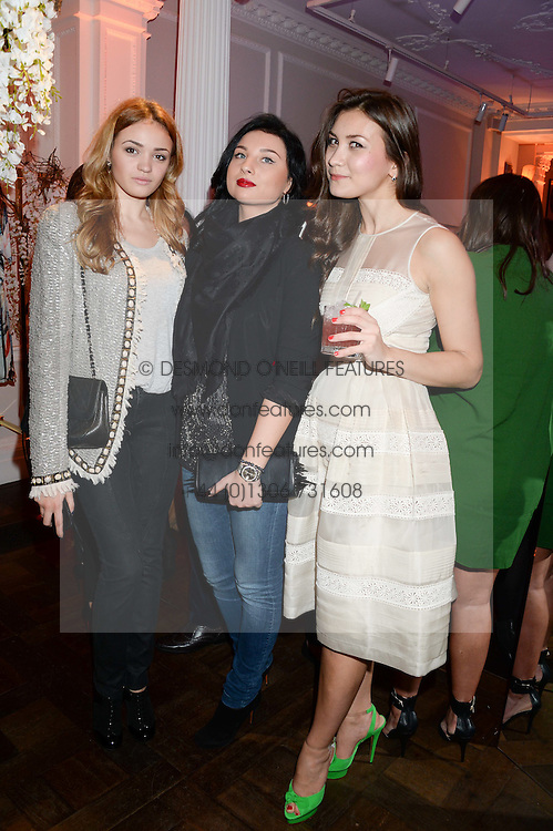 Left to right, VICTORIA TUGY, ALINA ZUDOVA and YULIA VOROBIEVA at the launch of Gordon's 'Ten Green Bottles' by Temperley London held at Temperley London Flagship, 27 Bruton Street, London on 6th November 2013.