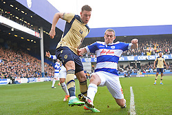 Leeds United's Connor Wickham and QPR's Richard Dunne compete for the ball - Photo mandatory by-line: Mitchell Gunn/JMP - Tel: Mobile: 07966 386802 01/03/2014 - SPORT - FOOTBALL - Loftus Road - London - Queens Park Rangers v Leeds United - Championship