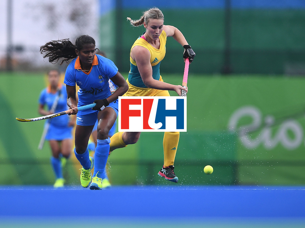Australia's Mariah Williams (R) and India's Sunita Lakra vie for the ball during the women's field hockey India vs Australia match of the Rio 2016 Olympics Games at the Olympic Hockey Centre in Rio de Janeiro on August, 10 2016. / AFP / MANAN VATSYAYANA        (Photo credit should read MANAN VATSYAYANA/AFP/Getty Images)