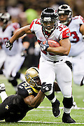 NEW ORLEANS, LA - DECEMBER 26:   Michael Turner #33 of the Atlanta Falcons runs the ball against the New Orleans Saints at Mercedes-Benz Superdome on December 26, 2011 in New Orleans, Louisiana.  The Saints defeated the Falcons 45-16.  (Photo by Wesley Hitt/Getty Images) *** Local Caption *** Michael Turner