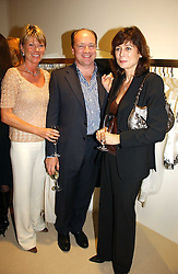Left to right, KATE SLATER, RUPERT FAIRFAX and LUCY MANNERS at a party to celebrate the launch of the Crine Gilson store at 12 Lowndes Street, London SW1 on 10th October 2006.<br /><br />NON EXCLUSIVE - WORLD RIGHTS
