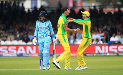 Australia's Mitchell Starc (centre) celebrates taking the wicket of England's Joe Root during the ICC Cricket World Cup group stage match at Lord's, London.