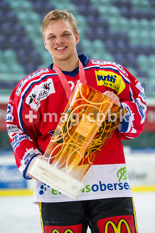 Rapperswil-Jona Lakers forward Noah Allabauer poses for a photo with his gold medal and the Swiss Champion trophy after winning the fifth Elite B Playoff Final ice hockey game between Rapperswil-Jona Lakers and ZSC Lions held at the SGKB Arena in Rapperswil, Switzerland, Sunday, Mar. 19, 2017. (Photo by Patrick B. Kraemer / MAGICPBK)
