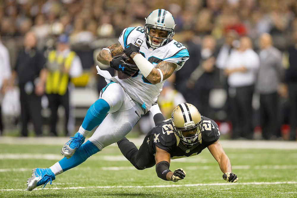 NEW ORLEANS, LA - DECEMBER 30:  Steve Smith #89 of the Carolina Panthers is tackled after making a catch by Patrick Robinson #21 of the New Orleans Saints at Mercedes-Benz Superdome on December 30, 2012 in New Orleans, Louisiana.  The Panthers defeated the Saints 44-38.  (Photo by Wesley Hitt/Getty Images) *** Local Caption *** Steve Smith; Patrick Robinson