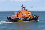The Royal National Lifeboat Institution RNLI Dover Life boat (17-09),  HM Coastguard rescue helicopter (G-C1JW)  and the RNLI Inshore lifeboat - (B-766) take part in a joint training exercise in in the sea outside Folkestone Harbour, Folkestone, Kent. UK. 6th August 2016 (photo by Andrew Aitchison / In pictures via Getty Images)