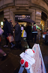 © Licensed to London News Pictures . 08/12/2012 . Manchester , UK . UKUncut hold a demonstration against corporate tax avoidance outside a branch of Starbucks on St Ann's Square in Manchester City Centre today (8th December 2012) . Photo credit : Joel Goodman/LNP