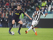 Eric Dier of Tottenham against Douglas Costa of Juventus during the Champions League Round of 16, leg 1 of 2 match between Juventus FC and Tottenham Hotspur at Juventus Stadium, Turin, Italy on 13 February 2018. Picture by Ahmad Morra