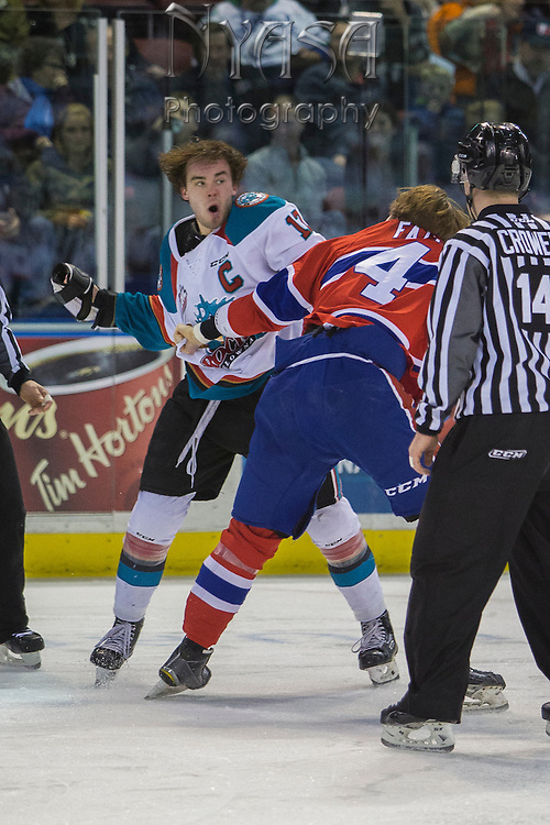 KELOWNA, CANADA - FEBRUARY 17:  Rodney Southam #17 of the Kelowna Rockets & Jeff Faith #4 of the Spokane Chiefs at the Kelowna Rockets game on February 17, 2017 at Prospera Place in Kelowna, British Columbia, Canada.  (Photo By Cindy Rogers/Nyasa Photography,  *** Local Caption ***