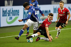 GELSENKIRCHEN, Jan. 22, 2018  Waldemar Anton (R, front) of Hannover and Alessandro Schoepf (L, front) of Schalke battle for the ball during the Bundesliga match between FC Schalke 04 and Hannover 96 at Veltins-Arena in Gelsenkirchen, Germany, on Jan. 21, 2018. (Credit Image: © Joachim Bywaletz/Xinhua via ZUMA Wire)