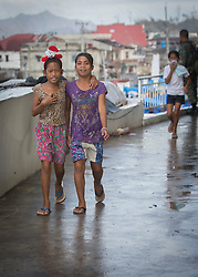 26/11/2013.  A young girl wears a Christmas hair band in the city of Tacloban more than 2 weeks after a super typhoon destroyed the city in the Phiippines.  Photo credit: Alison Baskerville/LNP