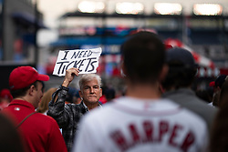 A man holds up a sign looking for tickets as Washington Nationals fans arrive for game four of the 2019 World Series at Nationals Park on October 26, 2019 in Washington, D.C.. The Nationals play the Houston Astros in the World Series Championship, a best of seven series. The Nationals lead the series 2-1.