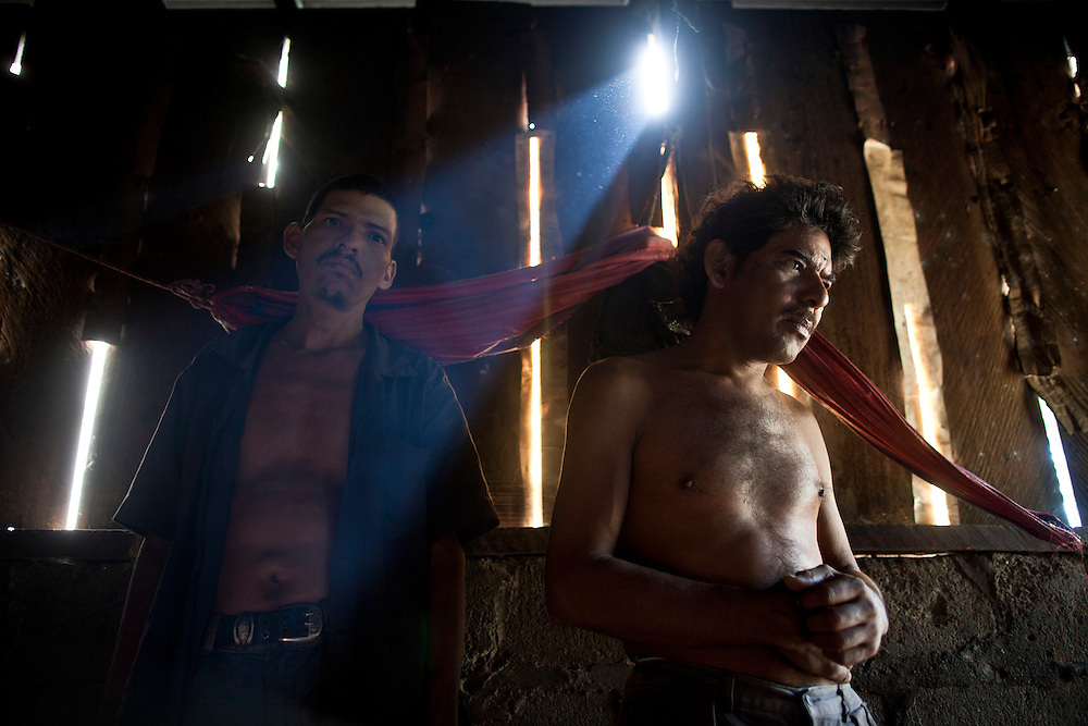 In this photo taken Thursday, Jan. 19, 2012, Brothers former sugar cane cutters of the San Antonio sugarmill,  Juan Cruz, 50, right, and Hilario Perez Cruz, 30, left, chronic renal failure patients, posses for a picture in a house in Trohilo, Leon, Nicaragua. A mysterious epidemic is devastating the Pacific coast of Central America, killing more than 24,000 people in El Salvador and Nicaragua since 2000 and striking thousands of others with chronic kidney disease at rates unseen virtually anywhere else. Many of the victims were manual laborers or worked in the sugarcane fields that cover much of the coastal lowlands.