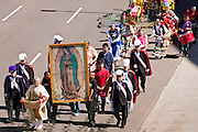 """10 OCTOBER 2010 - PHOENIX, AZ:  About 500 people processed through downtown Phoenix Sunday afternoon to honor the Virgin of Guadalupe, the """"Queen of the Americas."""" The procession was accompanied by 12 Matachine dance troupes. The Matachines are an important part of Mexican Catholic culture. They represent the battle of Good vs. Evil and the protect the Virgin from malevolent forces, represented by the demon like figures who accompany the dancers.      Photo by Jack Kurtz"""