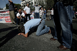 October 3, 2016 - Athens, Greece - A pensioner tries to comfort himself after tear gas usage from the riot police in Athens, on Monday October 3, 2016. Greek pensioners taking part at a protest march against pension cuts, demanted meeting with Prime minister but were stoped with tear gas by riot police close to the government's headquarters. (Credit Image: © Panayiotis Tzamaros/NurPhoto via ZUMA Press)