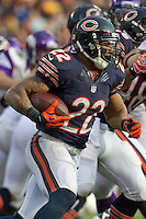 25 November 2012: Running back (22) Matt Forte of the Chicago Bears runs the ball against the Minnesota Vikings during the second half of the Bears 28-10 victory over the Vikings in an NFL football game at Soldier Field in Chicago, IL.