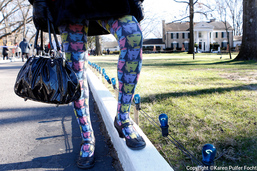 Meredith Benson,36, of New York, work Elvis tights and ear muffs to celebrate what would have been the 80th birthday of Elvis Presely at Graceland. She has been a fan since she was a teenager when she first heard his music. Priscilla Ann Presley, the ex-wife of the late singer Elvis Presley, and her daughter Lisa Marie, cut a birthday cake during a proclamation of Elvis Presley Day by Memphis and Shelby County officials at Graceland in Memphis, Tennessee January 8, 2015.  (photo by Karen Pulfer Focht)