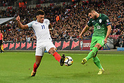 England midfielder Alex Oxlade-Chamberlain and Slovenia's Bojan Jokic  during the FIFA World Cup Qualifier match between England and Slovenia at Wembley Stadium, London, England on 5 October 2017. Photo by Martin Cole.