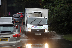 © Licensed to London News Pictures. 13/10/2014<br /> Road flooded in St Mary Cray,High Street,Orpington,Kent. (morning 13.10.2014)<br /> Heavy rain overnight has flooded roads in parts of South East London and Kent.<br /> (Byline:Grant Falvey/LNP)