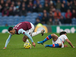 Dwight McNeil of Burnley (L) gets away from Andros Townsend of Crystal Palace - Mandatory by-line: Jack Phillips/JMP - 30/11/2019 - FOOTBALL - Turf Moor - Burnley, England - Burnley v Crystal Palace - English Premier League