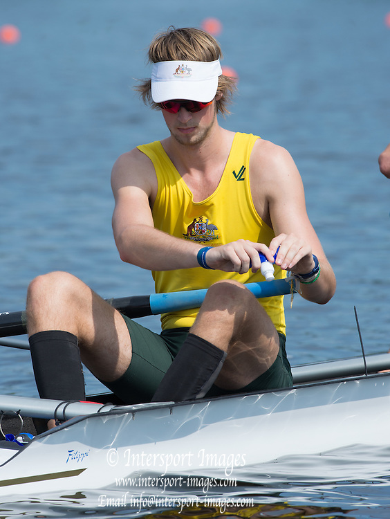 Hamburg. GERMANY. Australian Rower, squeeses the last of the water out of the refillable bottle. Wed afternoon heats at the 2014FISA Junior World rowing. Championships.  15:03:30  Wednesday  06/08/2014  [Mandatory Credit; Peter Spurrier/Intersport-images]