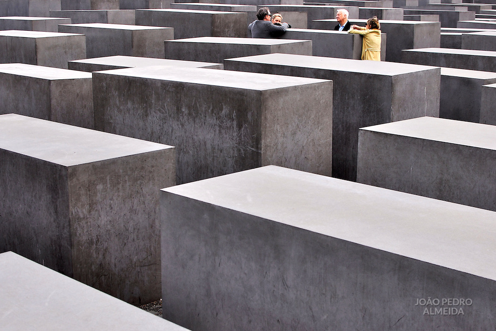 Group of people talking at Berlin's Holocaust Memorial
