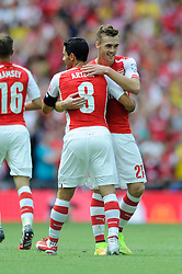 Arsenal's Callum Chambers celebrates Arsenal's Aaron Ramsey's goal with Arsenal's Mikel Arteta - Photo mandatory by-line: Dougie Allward/JMP - Mobile: 07966 386802 10/08/2014 - SPORT - FOOTBALL - London - Wembley Stadium - Arsenal v Manchester City - FA Community Shield