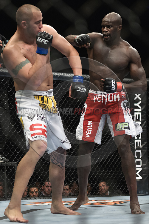 """LONDON, ENGLAND, OCTOBER 2010: Travis Browne (left) blocks a punch from Cheick Kongo during """"UFC 120: Bisping vs. Akiyama"""" inside the O2 Arena in Greenwich, London"""