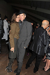 CARINE ROITFELD and JEFFERSON HACK at a dinner hosted by Calvin Klein Collection to celebrate the future Home of The Design Museum at The Commonwealth Institute, Kensington, London on 13th October 2011.